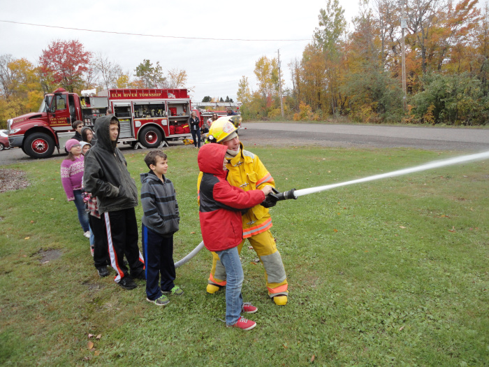 Practicing with fire hose