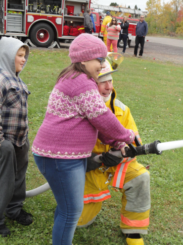 Children practicing with fire hose
