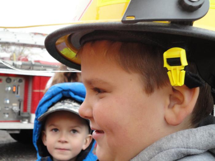 Child in fireman helmet
