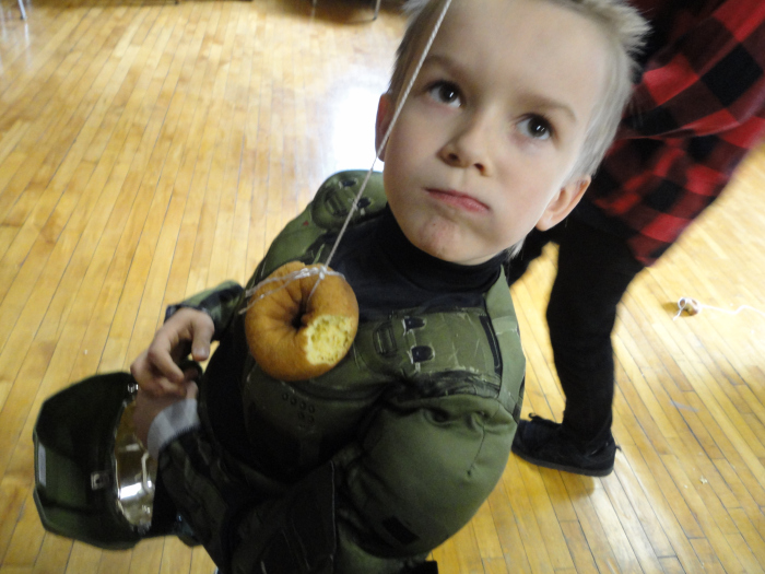 Posing with a donut