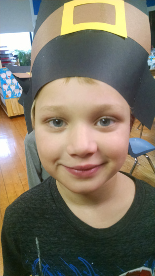 Posing with a pilgrim hat