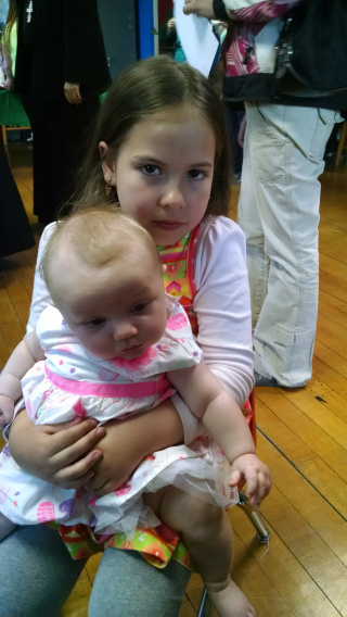 Student holding a baby
