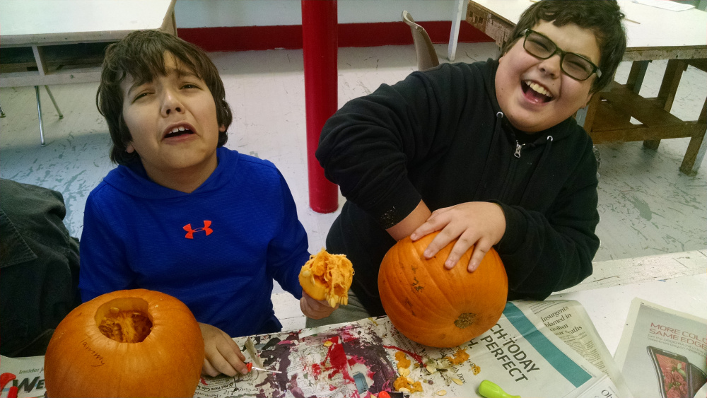 Carving pumpkins and reacting to innards